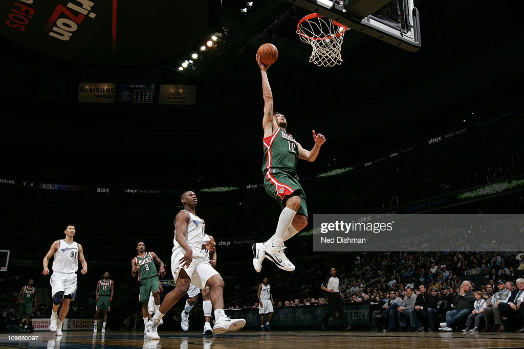 <a gi-track='captionPersonalityLinkClicked' href=/galleries/search?phrase=Carlos+Delfino&family=editorial&specificpeople=206625 ng-click='$event.stopPropagation()'>Carlos Delfino</a> #10 of the Milwaukee Bucks shoots against the Washington Wizards during the game at the Verizon Center on March 8, 2011 in Washington, DC.
