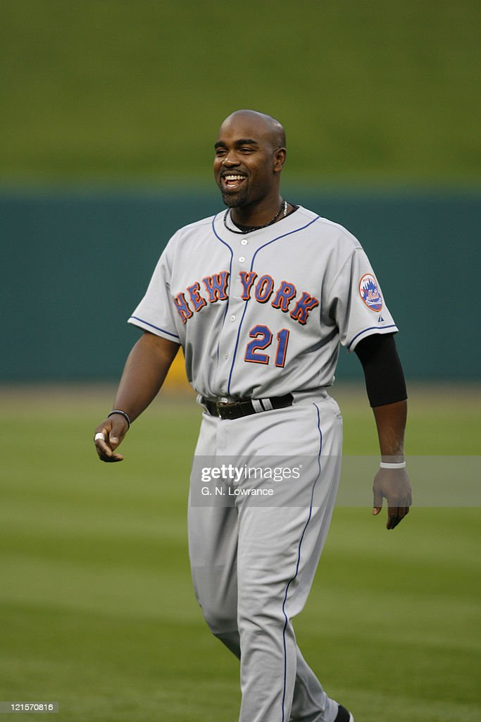 Carlos Delgado of the Mets has a laugh prior to action between the New York Mets and the St. Louis Cardinals at Busch Stadium in St. Louis, Missouri on May 16, 2006.