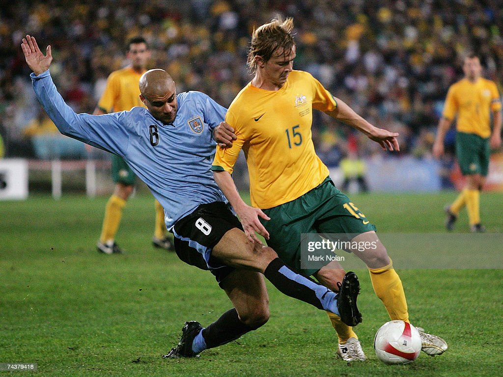 Carlos Diogo of Uruguay tackles Ryan Griffiths of Australia during the International Friendly match between Australia and Uruguay at Telstra Stadium...