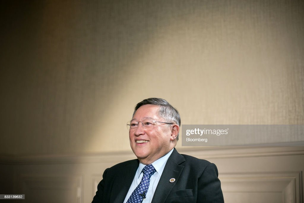Carlos Dominguez, the Philippines' secretary of finance, listens during a Bloomberg Television interview in Singapore, on Tuesday, Aug. 15, 2017. Dominguezsaid the economy is set to continue growing strongly, with a slump in the currency likely to be temporary. Photographer: Sam Kang Li/Bloomberg via Getty Images