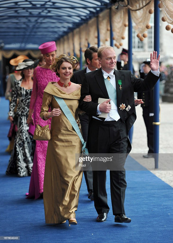 Carlos, Duke of Parma and Annemarie Gualthérie van Weezel leave following the inauguration ceremony for HM King Willem Alexander of the Netherlands, at New Church on April 30, 2013 in Amsterdam, Netherlands.