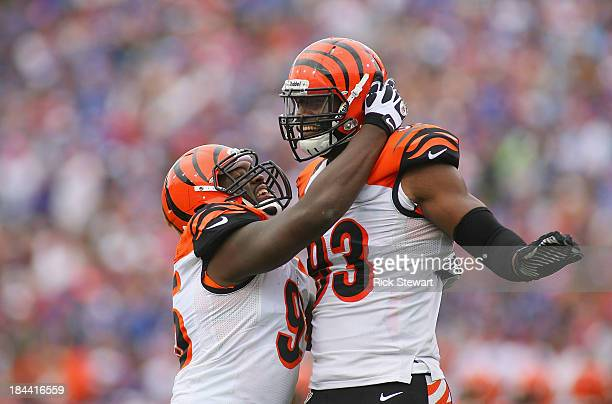 Carlos Dunlap and Michael Johnson of the Cincinnati Bengals celebrate a sack by Dunlap against the Buffalo Bills at Ralph Wilson Stadium on October...