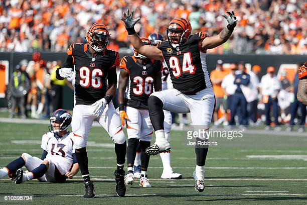 Carlos Dunlap of the Cincinnati Bengals and Domata Peko of the Cincinnati Bengals celebrate after making a defensive stop during the third quarter of...