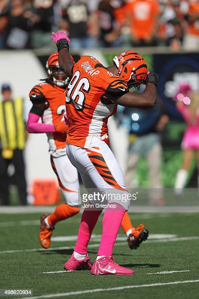 Carlos Dunlap of the Cincinnati Bengals celebrates a play during the game against the Kansas City Chiefs at Paul Brown Stadium on October 4 2015 in...