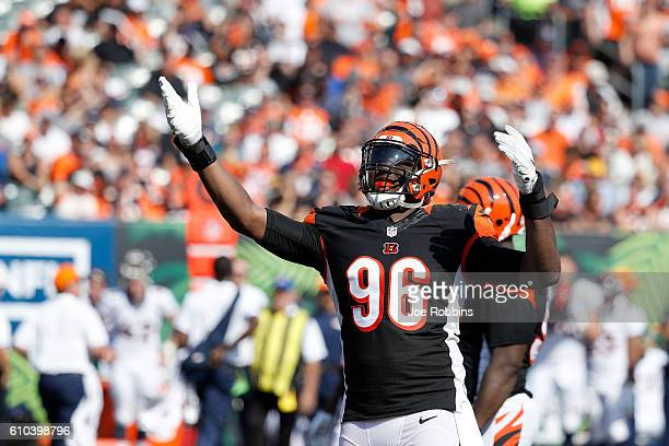 Carlos Dunlap of the Cincinnati Bengals celebrates after a defensive stop during the third quarter of the game against the Denver Broncos at Paul...
