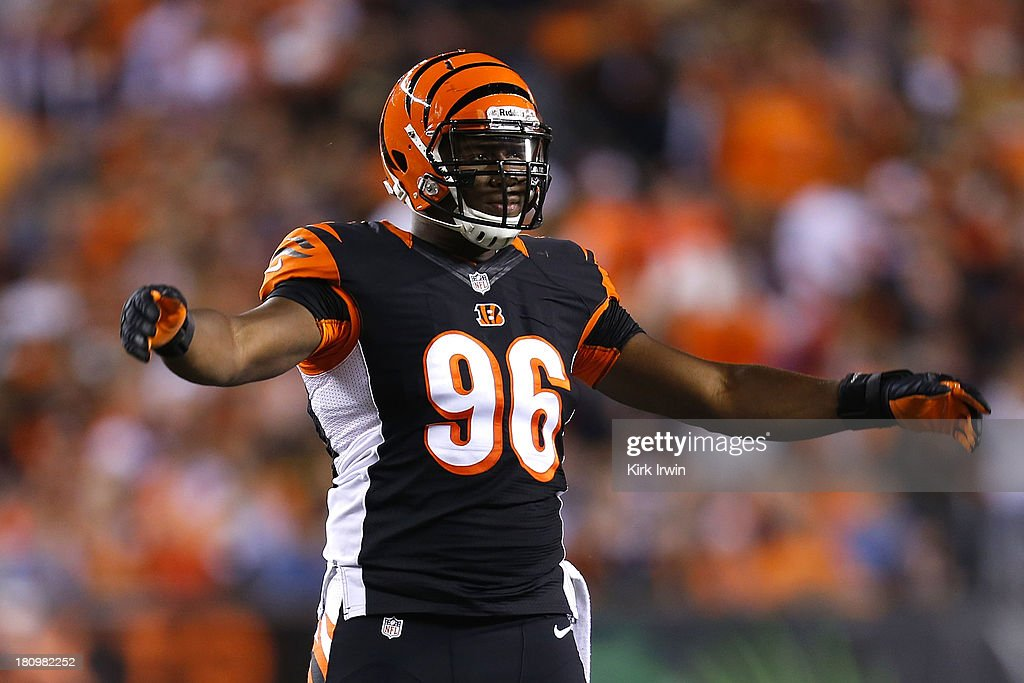 Carlos Dunlap #96 of the Cincinnati Bengals celebrates after making a play during the game against the Pittsburgh Steelers on September 16, 2013 at Paul Brown Stadium on September 16, 2013 in Cincinnati, Ohio. Cincinnati defeated Pittsburgh 20-10.