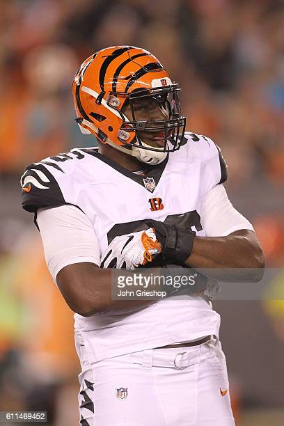 Carlos Dunlap of the Cincinnati Bengals celebrates after making a defensive stop during the third quarter of the game against the Miami Dolphins at...