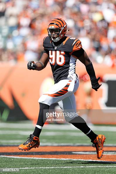 Carlos Dunlap of the Cincinnati Bengals celebrates after sacking Jake Locker of the Tennessee Titans during the third quarter at Paul Brown Stadium...