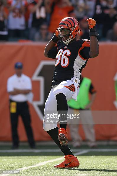Carlos Dunlap of the Cincinnati Bengals celebrates after sacking Russell Wilson of the Seattle Seahawks during the third quarter at Paul Brown...