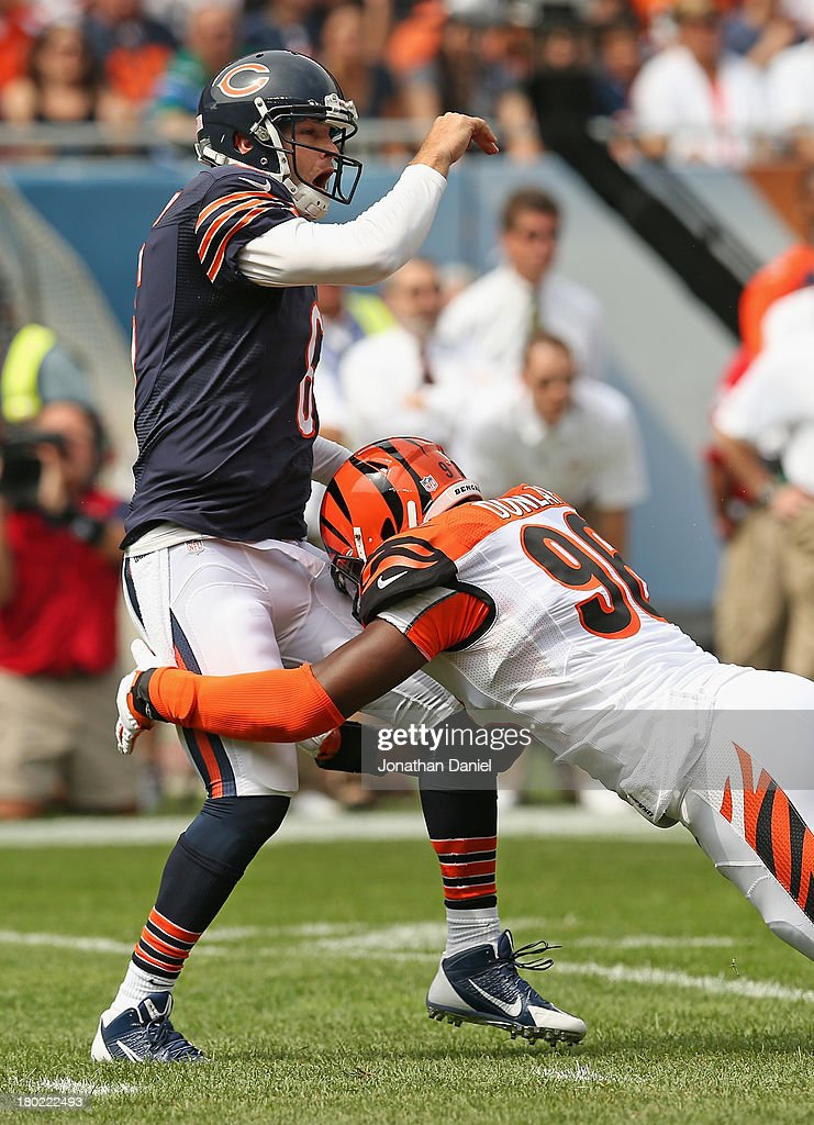 Carlos Dunlap #96 of the Cincinnati Bengals hits Jay Cutler #6 of the Chicago Bears after a pass at Soldier Field on September 8, 2013 in Chicago, Illinois. The Bears defeated the Bengals 24-21.