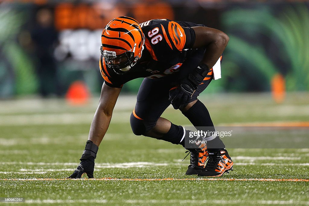 Carlos Dunlap #96 of the Cincinnati Bengals lines up for a play during the game against the Pittsburgh Steelers on September 16, 2013 at Paul Brown Stadium on September 16, 2013 in Cincinnati, Ohio. Cincinnati defeated Pittsburgh 20-10.