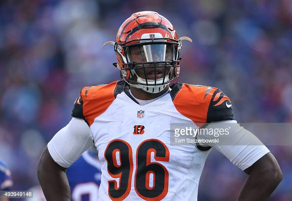 Carlos Dunlap of the Cincinnati Bengals looks on against the Buffalo Bills during NFL game action at Ralph Wilson Stadium on October 18 2015 in...