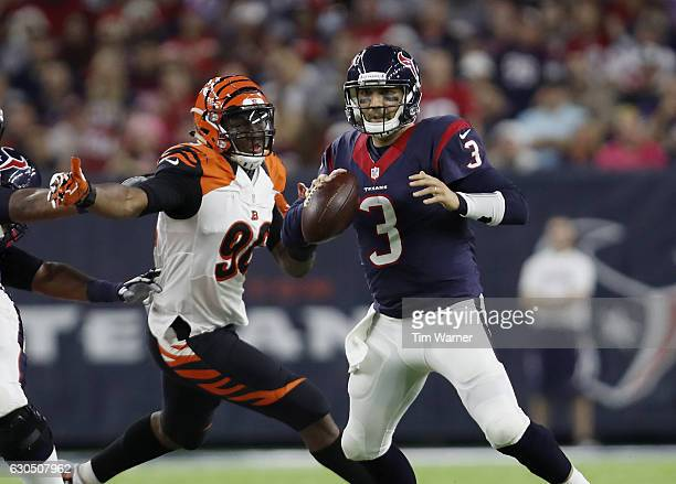 Carlos Dunlap of the Cincinnati Bengals pressures Tom Savage of the Houston Texans in the third quarter at NRG Stadium on December 24 2016 in Houston...