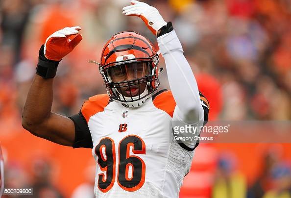 Carlos Dunlap of the Cincinnati Bengals pumps up the fans that traveled to Cleveland to cheer on the Bengals while playing the Cleveland Browns at...