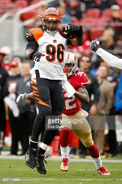 Carlos Dunlap of the Cincinnati Bengals runs with the ball after stripping Anquan Boldin of the San Francisco 49ers during their NFL game at Levi's...