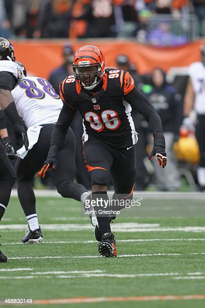 Carlos Dunlap of the Cincinnati Bengals rushes the quarterback during the game against the Baltimore Ravens at Paul Brown Stadium on December 29 2013...