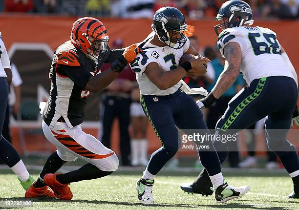 Carlos Dunlap of the Cincinnati Bengals sacks Russell Wilson of the Seattle Seahawks during the third quarter at Paul Brown Stadium on October 11...