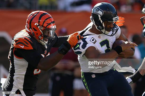 Carlos Dunlap of the Cincinnati Bengals sacks Russell Wilson of the Seattle Seahawks during the third quarter of the game at Paul Brown Stadium on...