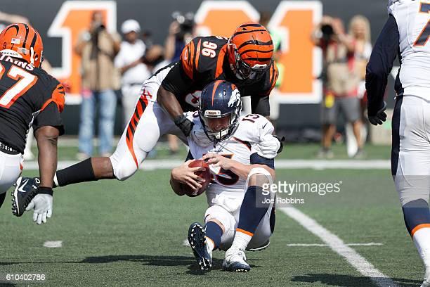 Carlos Dunlap of the Cincinnati Bengals sacks Trevor Siemian of the Denver Broncos during the second half at Paul Brown Stadium on September 25 2016...