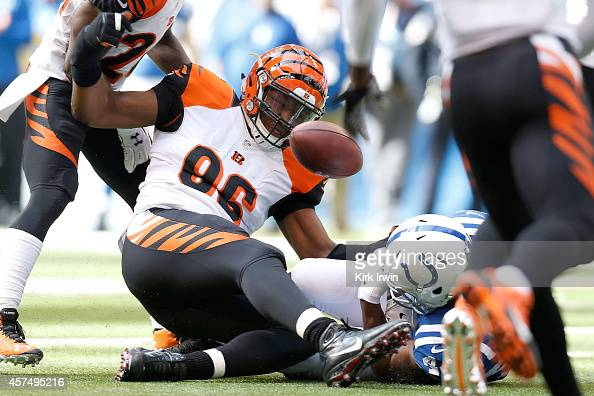 Carlos Dunlap of the Cincinnati Bengals strips the football from Ahmad Bradshaw of the Indianapolis Colts during the first quarter on October 19 2014...