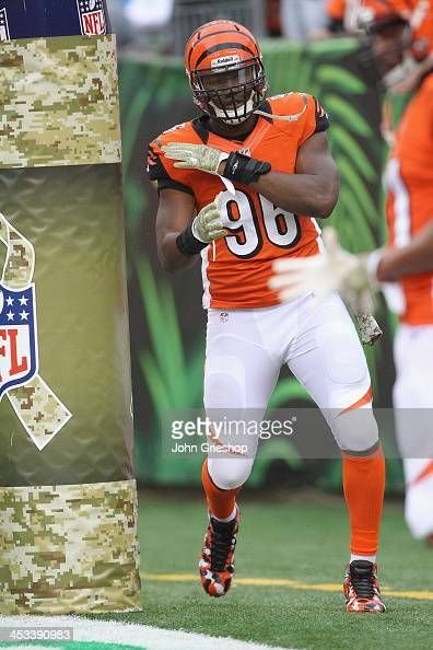 Carlos Dunlap of the Cincinnati Bengals warms up before the game against the Cleveland Browns at Paul Brown Stadium on November 17 2013 in Cincinnati...