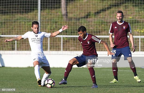 Carlos Eduardo of AC Viseu with Dieguinho of CD Cova da Piedade in action during the Segunda Liga match between CD Cova da Piedade and AC Viseu at...