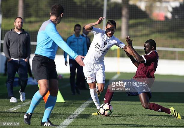 Carlos Eduardo of AC Viseu with Siaka Bamba of CD Cova da Piedade in action during the Segunda Liga match between CD Cova da Piedade and AC Viseu at...