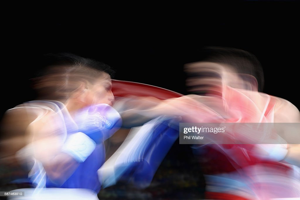 Carlos Eduardo Quipo Pilataxi of Ecuador fights GanErdrene Gankhuyag of Mongolia in their Mens 4649 Light Fly Weight bout on Day 3 of the Rio 2016...