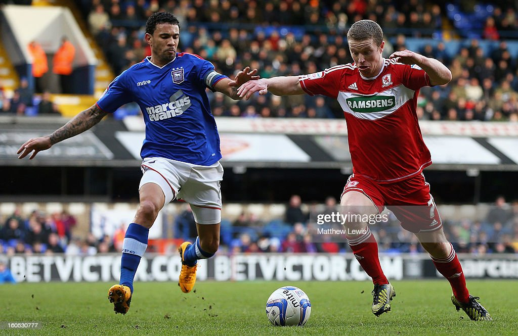 Carlos Edwards of Ipswich and Grant Leadbitter of Middlesbrough challenge for the ball during the npower Championship match between Ipswich Town and Middlesbrough at Portman Road on February 2, 2013 in Ipswich, England.