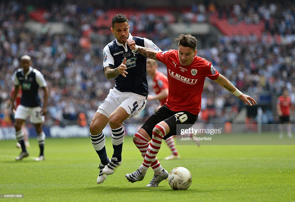 Carlos Edwards of Millwall FC and Adam Hammill of Barnsley FC during the Sky Bet League One Play Off Final between Barnsley and Millwall at Wembley Stadium on May 29, 2016 in London, England.
