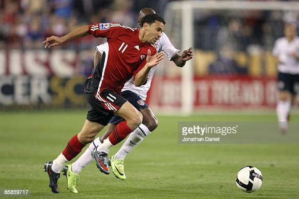Carlos Edwards of Trinidad and Tobago paces the ball across the field during a FIFA 2010 World Cup Qualifying match against the United States on...