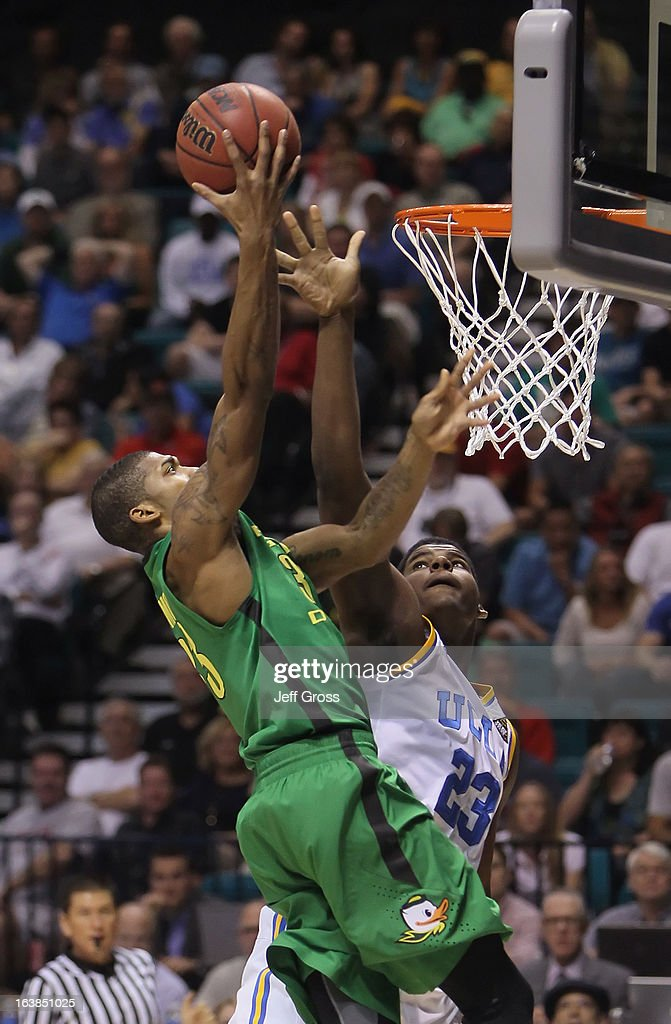 Carlos Emory #33 of the Oregon Ducks drives to the basket while defended by <a gi-track='captionPersonalityLinkClicked' href=/galleries/search?phrase=Tony+Parker+-+Basketball+Player+-+Born+1993&family=editorial&specificpeople=15286432 ng-click='$event.stopPropagation()'>Tony Parker</a> #23 of the UCLA Bruins in the first half during the Pac-12 Championship game at the MGM Grand Garden Arena on March 16, 2013 in Las Vegas, Nevada. Oregon defeated UCLA