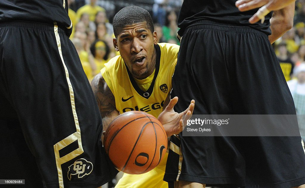 Carlos Emory #33 of the Oregon Ducks passes the ball between Shane Harris-Tunks #15 of the Colorado Buffaloes and Andre Roberson #21 of the Colorado Buffaloes in the second half of the game at Matthew Knight Arena on February 7, 2013 in Eugene, Oregon. Colorado won the game 48-47.