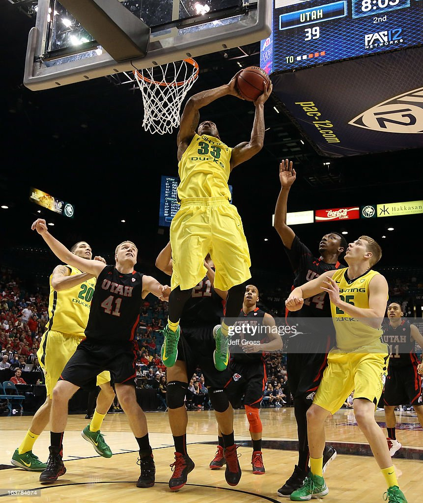 Carlos Emory #33 of the Oregon Ducks shoots the ball in the lane against Jeremy Olsen #41 of the Utah Utes in the second half during the semifinals of the Pac-12 tournament at the MGM Grand Garden Arena on March 14, 2013 in Las Vegas, Nevada.