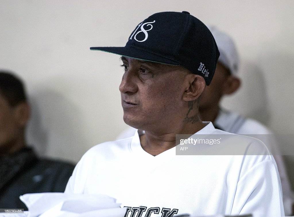 Carlos Ernesto Mojica Lechuga, aka 'El Viejo Lin', member of the Barrio 18 gang, attends a press conference where leaders of the five gangs --Mara Salvatrucha (MS-13), Barrio 18, MAO-MAO, Máquina and Mirada Locos-- demand the US to support the truce they started on 2012 --which had already lowered the daily murder rate from 14 to 5-- on January 28, 2013 at La Esperanza prison in San Salvador. The US State Department recently issued a travel warning to US citizens about the security situation in El Salvador. The leaders have assured tourists their safety and well-being while visiting the country and have given instructions to their members to respect them. AFP PHOTO/ Juan CARLOS
