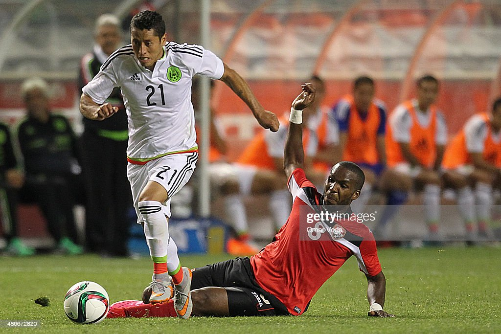 Carlos Esquivel of Mexico (L) dribbles <a gi-track='captionPersonalityLinkClicked' href=/galleries/search?phrase=Khaleem+Hyland&family=editorial&specificpeople=5366394 ng-click='$event.stopPropagation()'>Khaleem Hyland</a> of Tirnidad and Tobago (R) during a friendly match between Mexico and Trinidad and Tobago at Rio Tinto Stadium on September 04, 2015 in Sandy, Utah.
