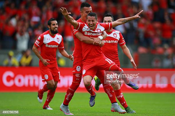 Carlos Esquivel of Toluca celebrates with teammates after scoring the fourth goal of his team during the 13th round match between Toluca and...