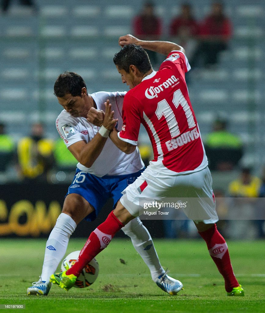 Carlos Esquivel of Toluca (R) fights for the ball with Adrian Romero of Nacional de Uruguay (L) during a match for the Bridgestone Libertadores Cup at Nemesio Diez on February 19, 2013 in Toluca, Mexico.