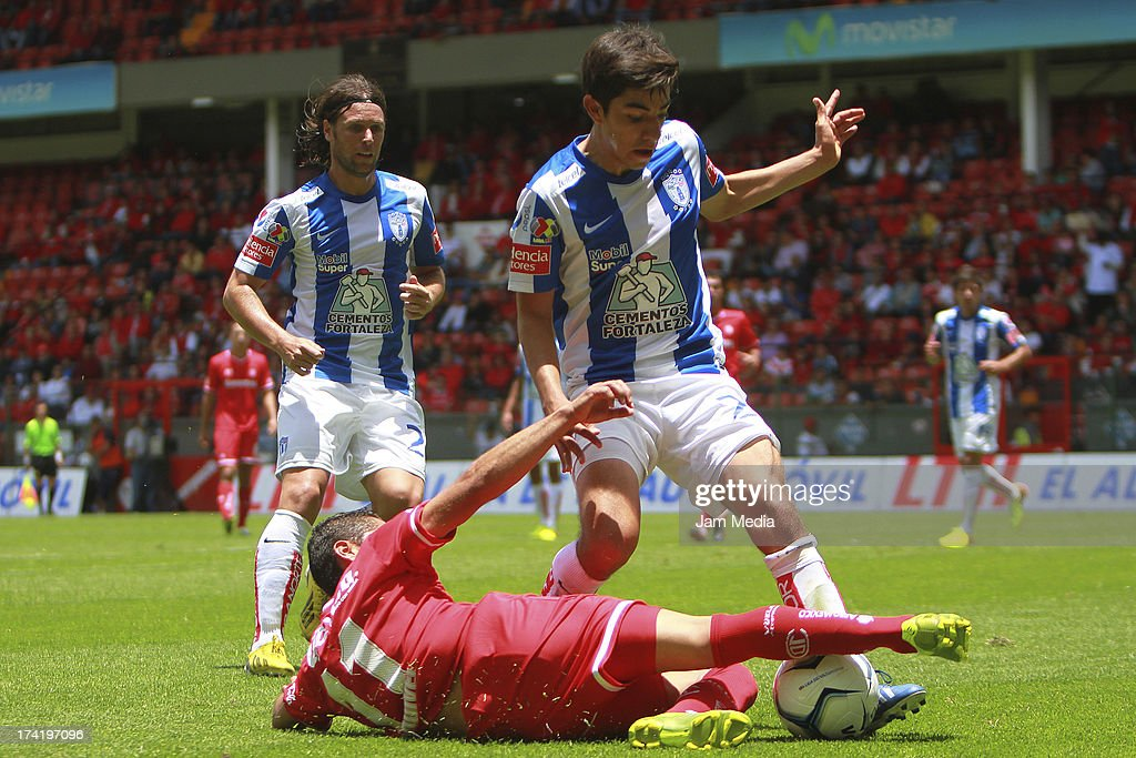 Carlos Esquivel of Toluca struggles for the ball with Rodolfo Pizarro (L) of Tijuana during the match between Toluca and Pachuca as part of the Apertura 2013 Liga Bancomer MX at Nemesio Diez Stadium on july 21, 2013 in Toluca, Mexico.