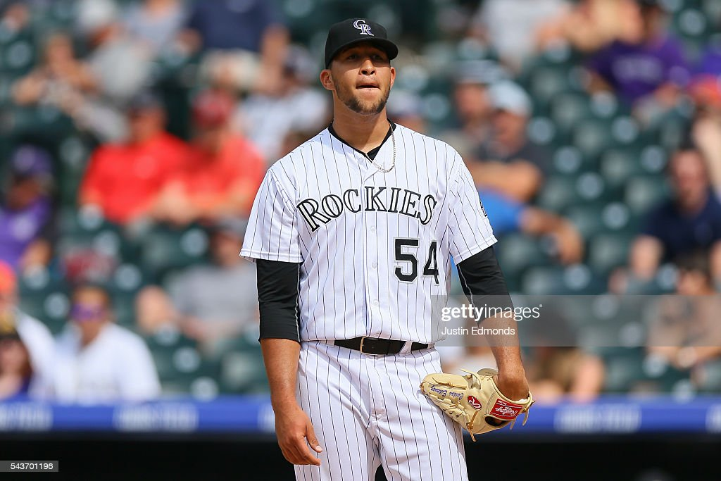 Carlos Esteves #54 of the Colorado Rockies reacts after giving up a run off of a wild pitch during the ninth inning against the Toronto Blue Jays at Coors Field on June 29, 2016 in Denver, Colorado. The Blue Jays defeated the Rockies 5-3.