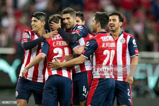 Carlos Fierro of Chivas celebrates with teammates after scoring the winning penalty in a friendly match between Chivas and Boca Juniors at Chivas...