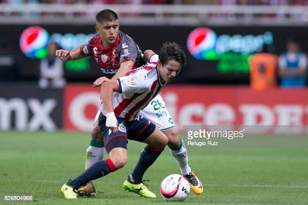 Carlos Fierro of Chivas fights for the ball with Jairo Gonzalez of Necaxa during the third round match between Chivas and Necaxa as part of the...