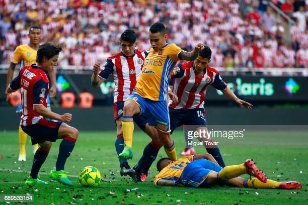 Carlos Fierro of Chivas fights for the ball with Lucas Zelarayan of Tigres during the Final second leg match between Chivas and Tigres UANL as part...