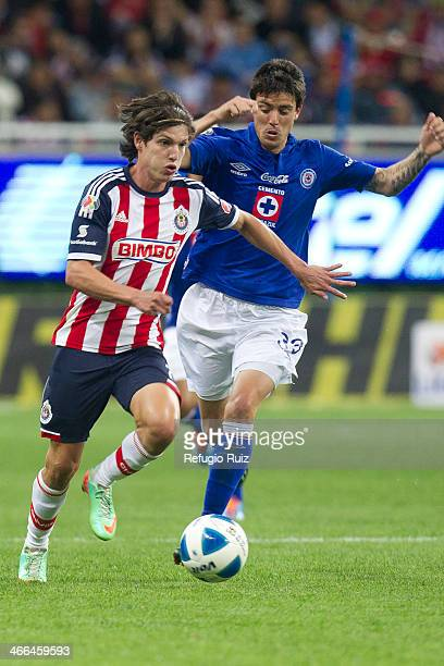 Carlos Fierro of Chivas fights for the ball with Mauro Formica of Cruz Azul during a match between Chivas and Cruz Azul as part of the Clausura 2014...