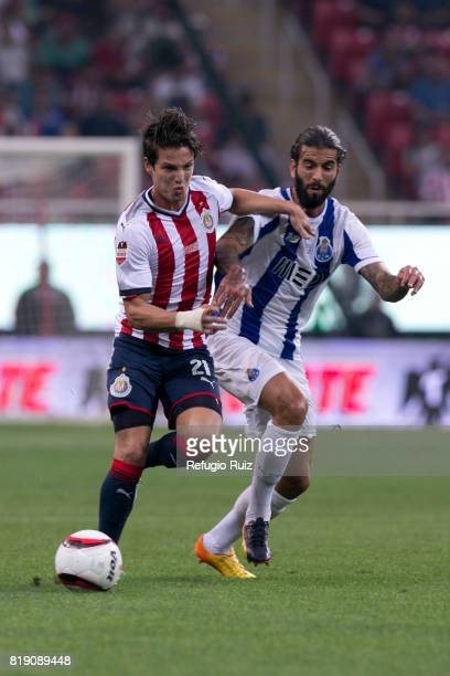 Carlos Fierro of Chivas fights for the ball with Maxi Pereira of Porto during the friendly match between Chivas and Porto at Chivas Stadium on July...