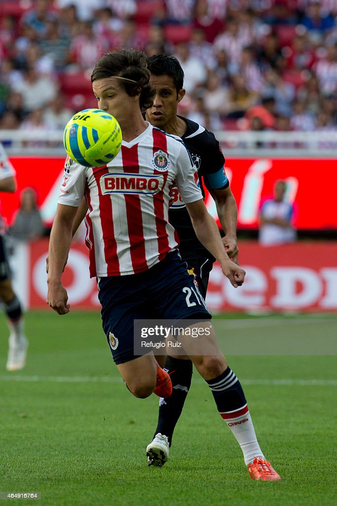 Carlos Fierro of Chivas fights for the ball with Severo Meza of Monterrey during a match between Chivas and Monterrey as part of 8th round Clausura...