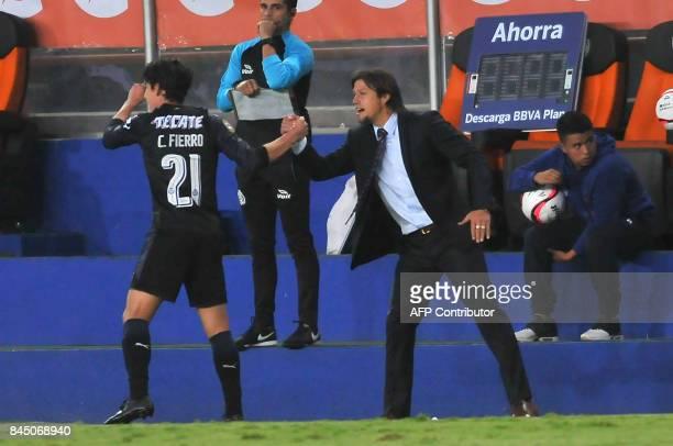 Carlos Fierro of Guadalajara celebrates with his coach Matias Almeyda his goal against Pachuca during their Mexican Apertura tournament football...