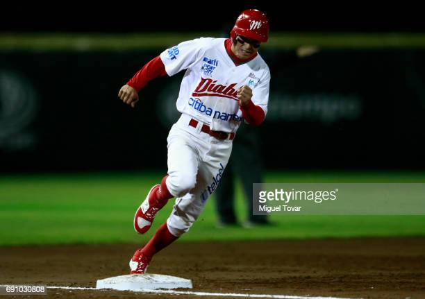 Carlos Figueroa of Diablos runs the third base during the match between Toros de Tijuana and Diablos Rojos as part of the Liga Mexicana de Beisbol...