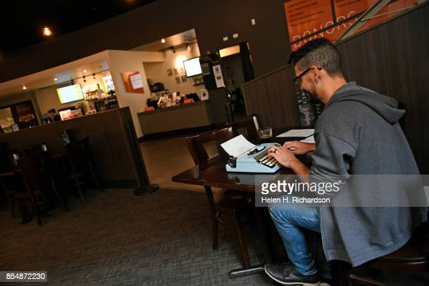 DENVER CO SEPTEMBER 27 Carlos Flores uses an old typewriter to work on his screenplay at Henderson's Lounge inside the Denver Film Society's SIE...