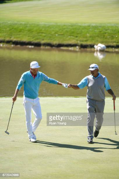 Carlos Franco fist bumps Jesper Parnevik on the seventh hole during the final round of the PGA TOUR Champions Bass Pro Shops Legends of Golf at Big...